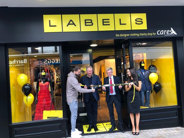 Jay Rodriguez officially opens Labels, watched on by CARES founder and Burnley FC director John Banaszkiewicz, Burnley chief executive Mick Cartklede and Labels retail manager Sarah Walker.