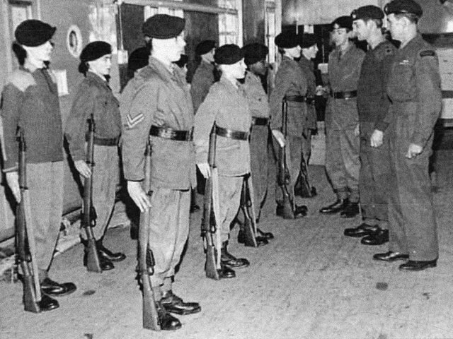 Preston Marine Cadets in Strand Road in Preston. The squad are pictured being inspected by the OCMD Brian Beardsworth and the Adjutant Jock McLeod (nearest the camera)