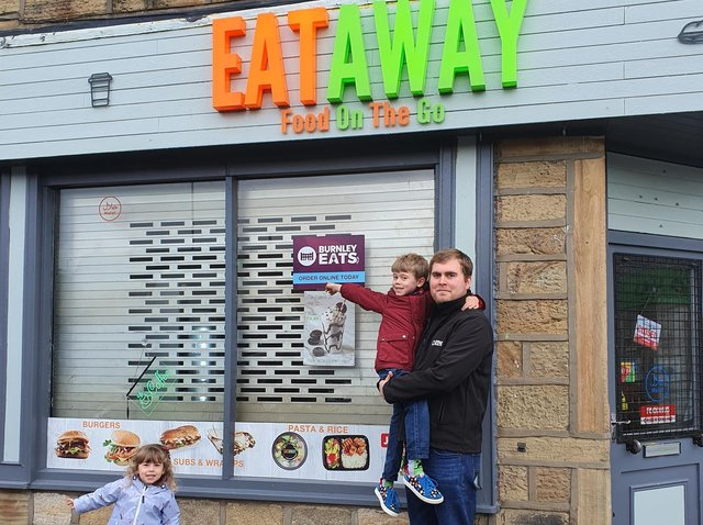 Luke Nixon, of Burnley Eats, with his son Ethan (six) and daughter Edith who is two