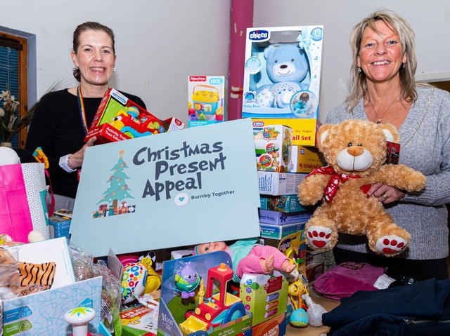 Pictured with just some of the fantastic presents for the Burnley Christmas Toy Appeal are Alicia Foley, Community Investment Manager at Calico Homes (left) and Lynne Blackburn, Project Manager at Participation Works.
