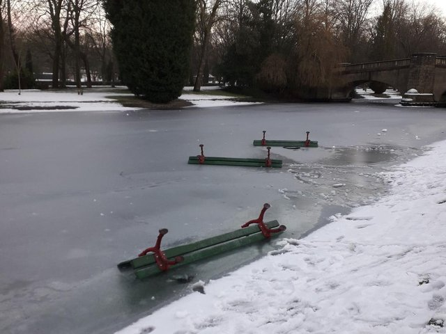 Andy Robinson took this photograph of three of the the benches on the ice at the lake in Burnley's Thompson Park.