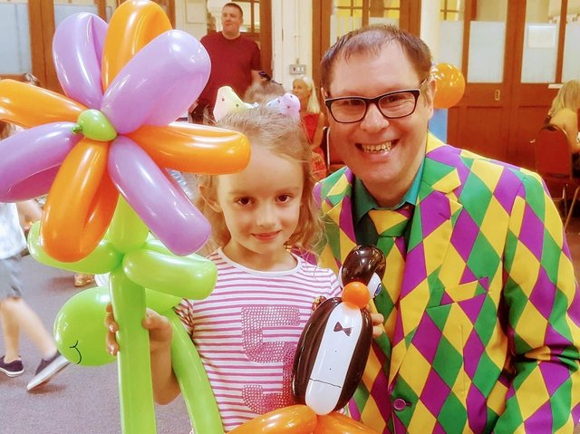 Colne conjuror Darren Lee and a young fan