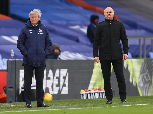 Crystal Palace's English manager Roy Hodgson (L) and Burnley's English manager Sean Dyche look on from the side-lines during the English Premier League football match between Crystal Palace and Burnley at Selhurst Park in south London on February 13, 2021.