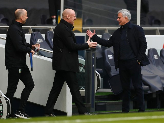 Jose Mourinho (R), Manager of Tottenham Hotspur interacts with Sean Dyche, Manager of Burnley prior to the Premier League match between Tottenham Hotspur and Burnley at Tottenham Hotspur Stadium on February 28, 2021 in London, England.