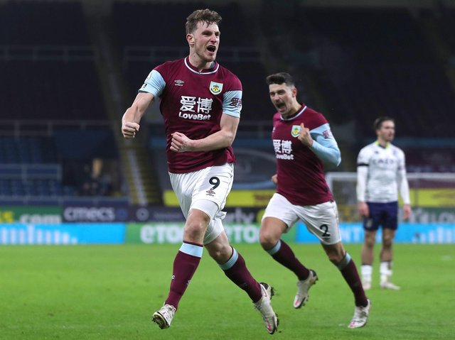 Chris Wood of Burnley celebrates after scoring their sides third goal during the Premier League match between Burnley and Aston Villa at Turf Moor on January 27, 2021 in Burnley, England.