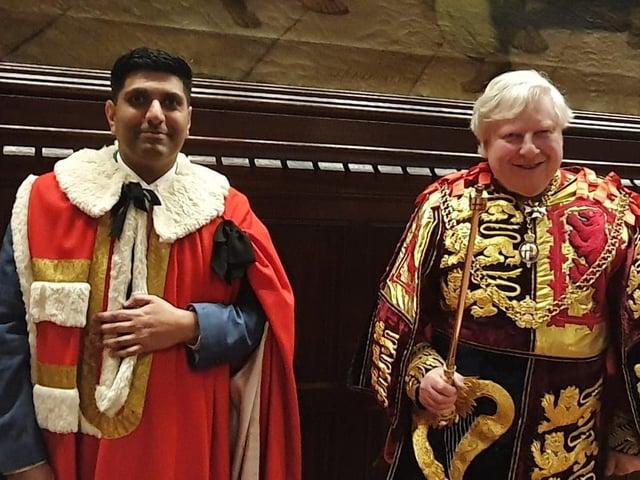 Lord Khan of Burnley with Garter Principal King of Arms Mr Thomas Woodcock