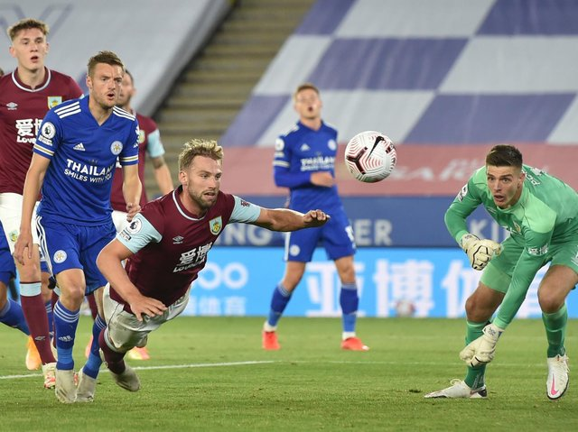 Burnley's English defender Charlie Taylor heads the ball away during the English Premier League football match between Leicester City and Burnley at King Power Stadium in Leicester, central England on September 20, 2020.