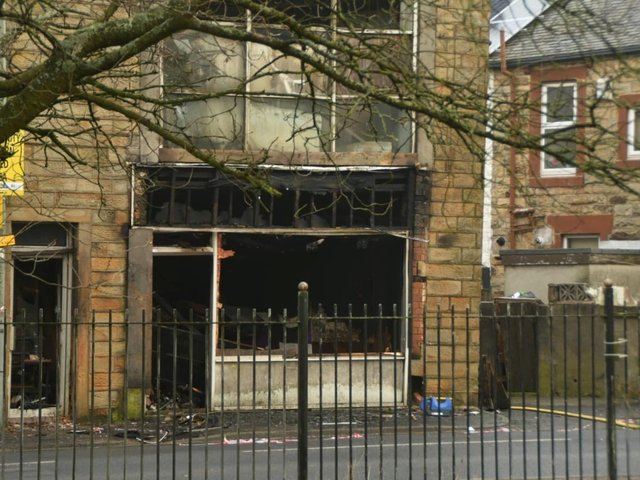 The aftermath of the fire that tore through a derelict shop in Burnley in the early hours of this morning