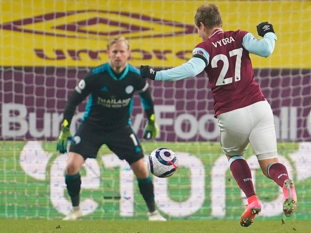 Burnley's Czech striker Matej Vydra (R) breaks through to score the opening goal during the English Premier League football match between Burnley and Leicester City at Turf Moor in Burnley, north west England on March 3, 2021.
