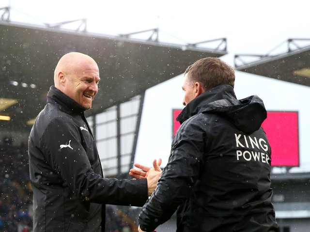 Sean Dyche, Manager of Burnley shakes hands with Brendan Rodgers, Manager of Leicester City prior to the Premier League match between Burnley FC and Leicester City at Turf Moor on March 16, 2019 in Burnley, United Kingdom.