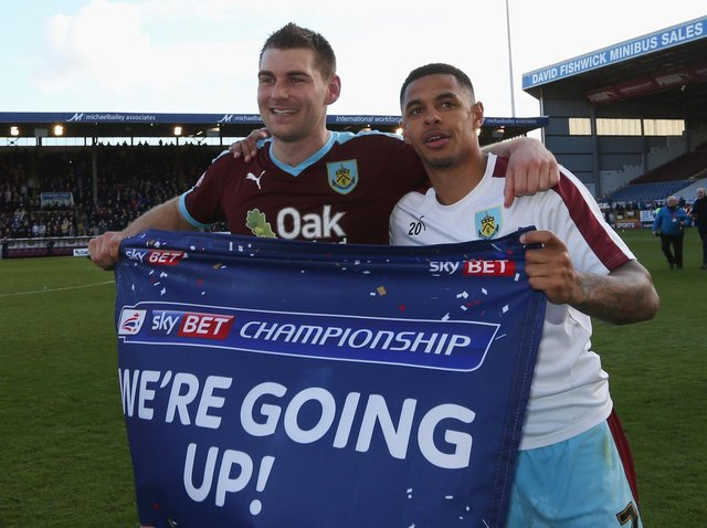 Sam Vokes (9) and Andre Gray of Burnley (7) celebrate as they are promoted to the Premier League after the Sky Bet Championship match between Burnley and Queens Park Rangers at Turf Moor on May 2, 2016 in Burnley, United Kingdom.
