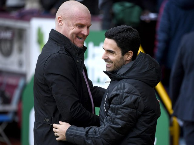 Sean Dyche, Manager of Burnley embraces Mikel Arteta, Manager of Arsenal prior to the Premier League match between Burnley FC and Arsenal FC at Turf Moor on February 02, 2020 in Burnley, United Kingdom.