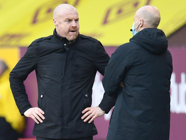 Burnley's English manager Sean Dyche (L) talks to the fourth official during the English Premier League football match between Burnley and Arsenal at Turf Moor in Burnley, north west England on March 6, 2021.