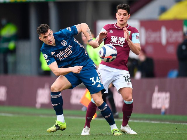 Arsenal's Swiss midfielder Granit Xhaka vies with Burnley's English midfielder Ashley Westwood during the English Premier League football match between Burnley and Arsenal at Turf Moor in Burnley, north west England on March 6, 2021.