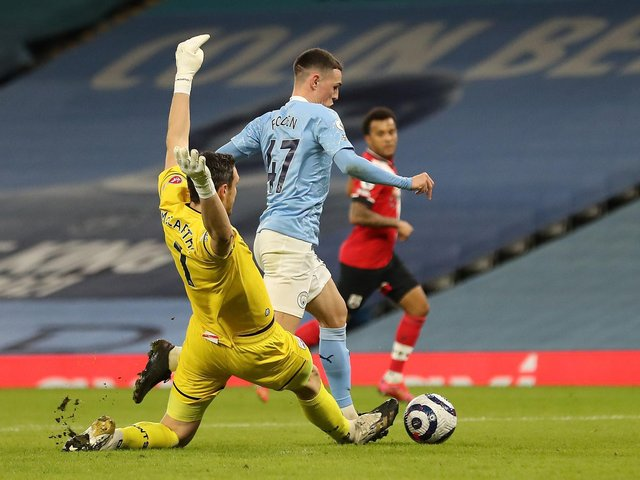 Phil Foden is brought down by Alex McCarthy