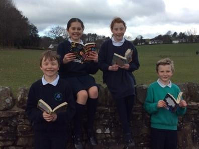 Harvey, Leah, Bella and Owain are just four of the champion book readers at Read St John's CE Primary School