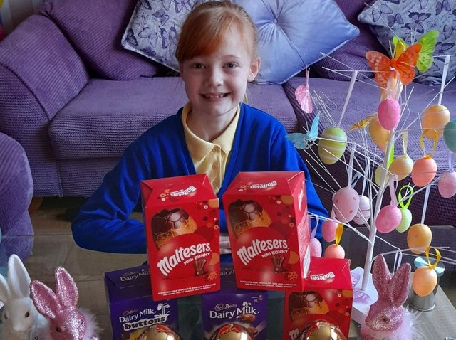 Elsie Whitehall (eight) with some of the Easter egg donations for the Burnley Community Kitchen