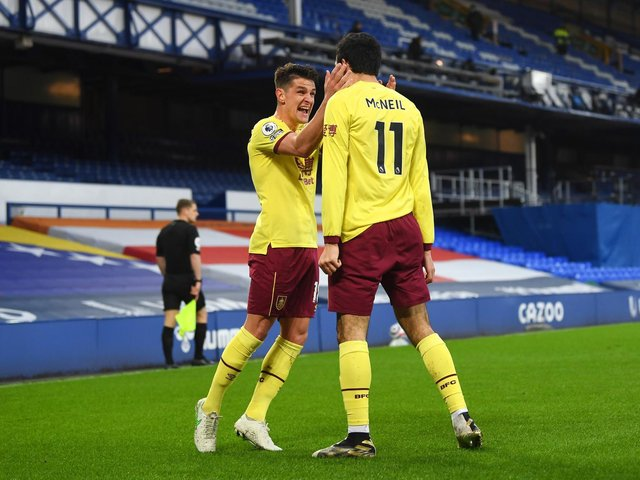 Ashley Westwood celebrates with Dwight McNeil at Everton