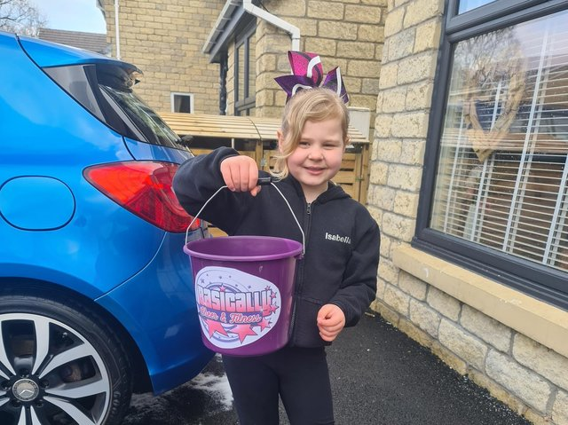 Isabella Dale (seven) raised £100 for her dance school by washing cars