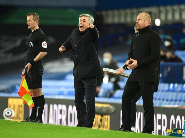 Everton's Italian head coach Carlo Ancelotti reacts as Burnley's English manager Sean Dyche looks on during the English Premier League football match between Everton and Burnley at Goodison Park in Liverpool, north west England on March 13, 2021.