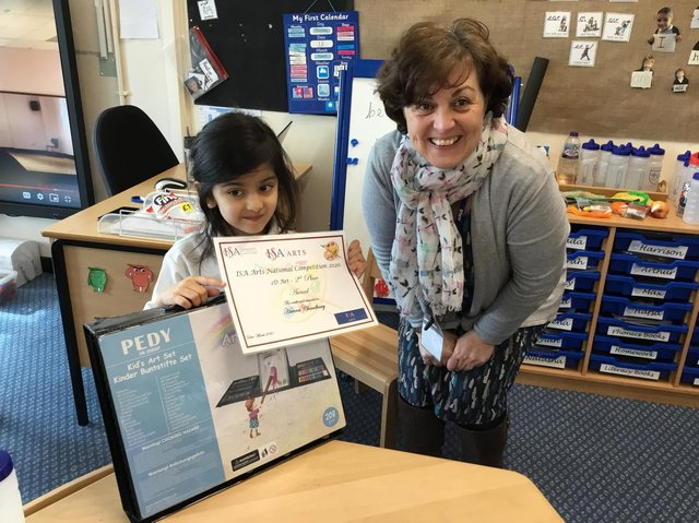Hanna is presented with a certificate from teacher Susana Hannah