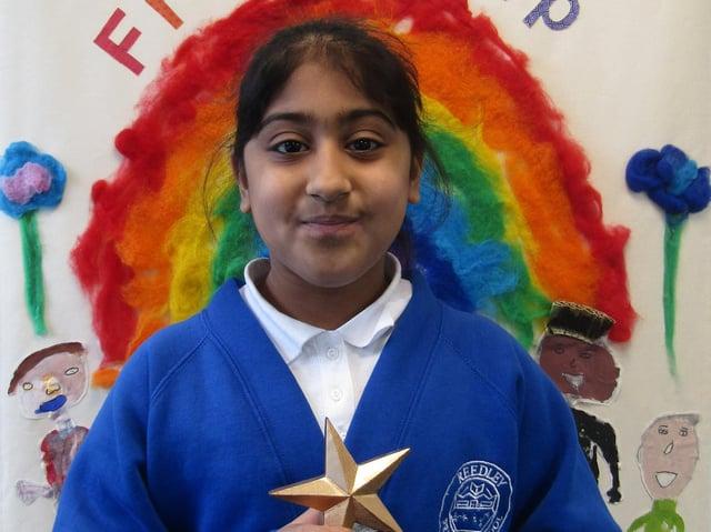 Aminah with her award