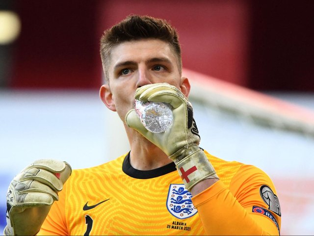 Nick Pope takes a drink in Albania