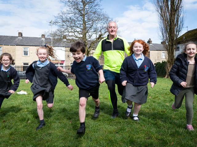 Charlie Briggs gets in training for the London Marathon with the help of Burnley youngsters (left to right)  Naomi Rochester, Sadie Phillipson, Jamie Woods ,Ruby Jephcott and Amelia Fenemore