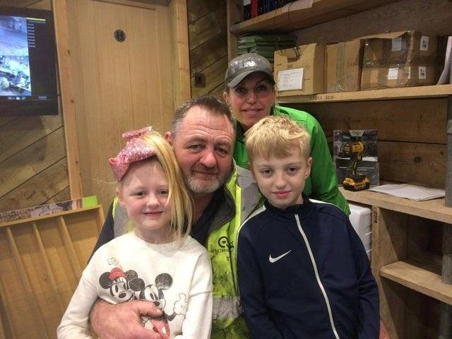 Mark Hanson, the owner of Quicker Skips, with his wife Adele and their children Charlie and Ella, is handing out 200 Easter eggs to youngsters on Good Friday.