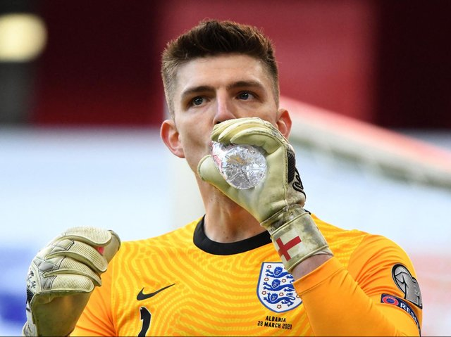 England's goalkeeper Nick Pope drinks water during the FIFA World Cup Qatar 2022 qualification Group I football match between Albania and England at the Air Albania Stadium, in Tirana on March 28, 2021.