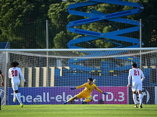 Dwight McNeil, right, looks on as Eberechi Eze scores from the spot