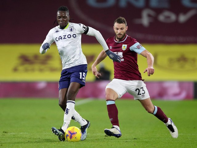 Bertrand Traore of Aston Villa is challenged by during the Premier League match between Burnley and Aston Villa at Turf Moor on January 27, 2021 in Burnley, England.