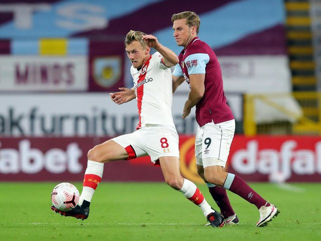 James Ward-Prowse of Southampton battles for possession with Chris Wood of Burnley during the Premier League match between Burnley and Southampton at Turf Moor on September 26, 2020 in Burnley, England.