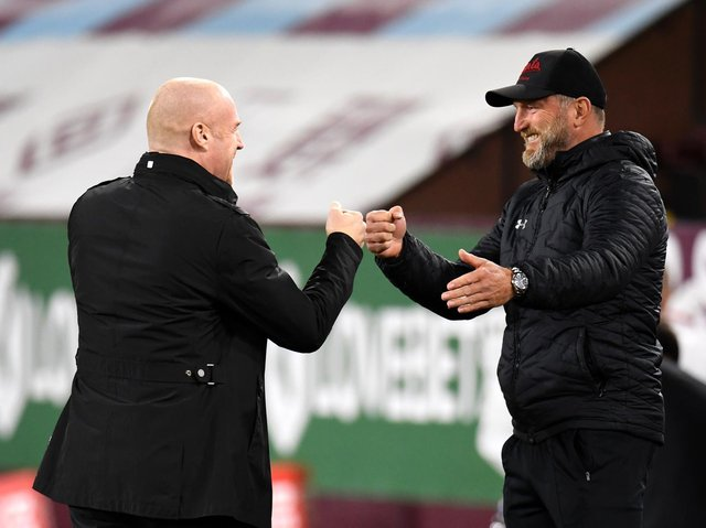 Sean Dyche, Manager of Burnley and Ralph Hasenhuttl, Manager of Southampton interact prior to the Premier League match between Burnley and Southampton at Turf Moor on September 26, 2020 in Burnley, England.
