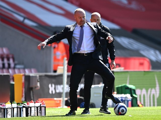 Sean Dyche, Manager of Burnley controls the ball during the Premier League match between Southampton and Burnley at St Mary's Stadium on April 04, 2021 in Southampton, England.