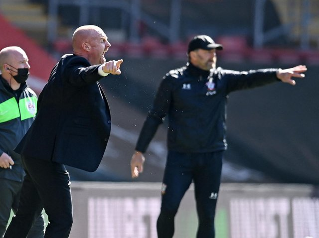 Burnley's English manager Sean Dyche (L) and Southampton's Austrian manager Ralph Hasenhuttl (R) gesture from the sidelines during the English Premier League football match at St Mary's Stadium in Southampton, southern England on April 4, 2021.