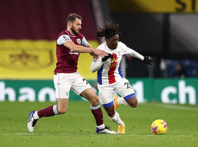 Eberechi Eze of Crystal Palace is challenged by Erik Pieters of Burnley during the Premier League match between Burnley and Crystal Palace at Turf Moor on November 23, 2020 in Burnley, England.