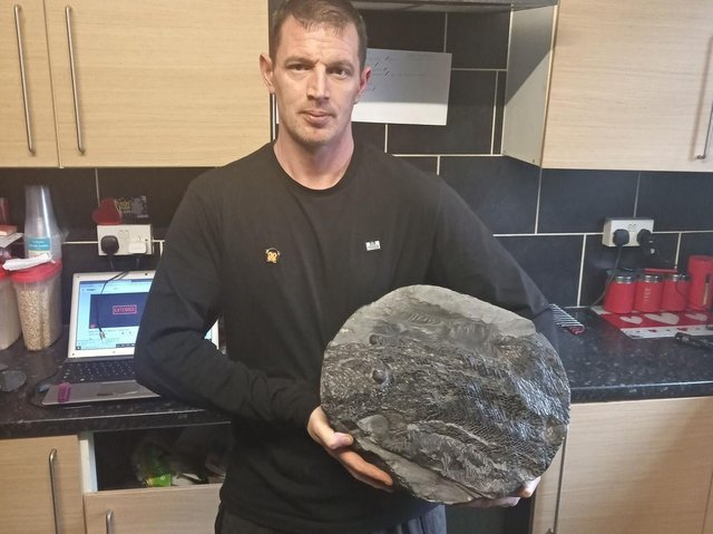 Damion Whitton with the rare fish fossil he discovered in Burnley