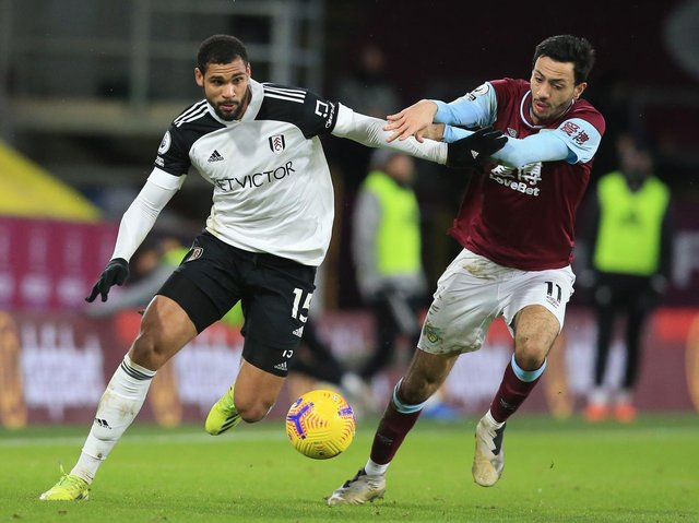 Fulham's English midfielder Ruben Loftus-Cheek (L) vies with Burnley's English midfielder Dwight McNeil during the English Premier League football match between Burnley and Fulham at Turf Moor in Burnley, north west England on February 17, 2021.