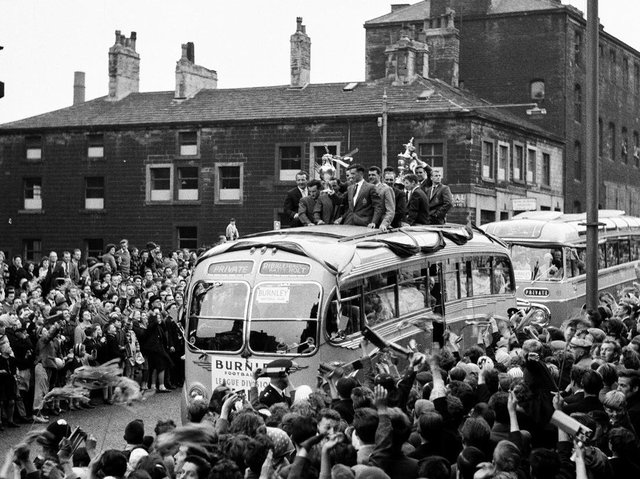 Happy memories. Harry Potts is on this celebration bus as it toured Burnley after the club won the 1959/60 Division One title trophy.