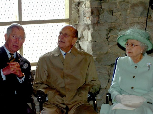 Prince Philip on a visit to Burnley in 2012 with Prince Charles and Her Majesty the Queen