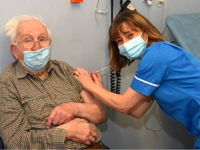 Mr F. Jackson receives his vaccine from Clitheroe nurse Shelley Posthuma de Boer
