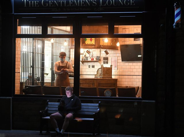 Waiting for midnight - first customer Cam Wilkinson pictured outside The Gentlemen's Lounge, Longridge  waiting for barber Ike Walmsley to open for business.  Photo: Neil Cross
