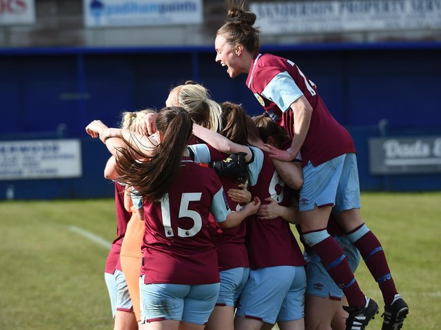 Burnley FC Women celebrate their shootout success