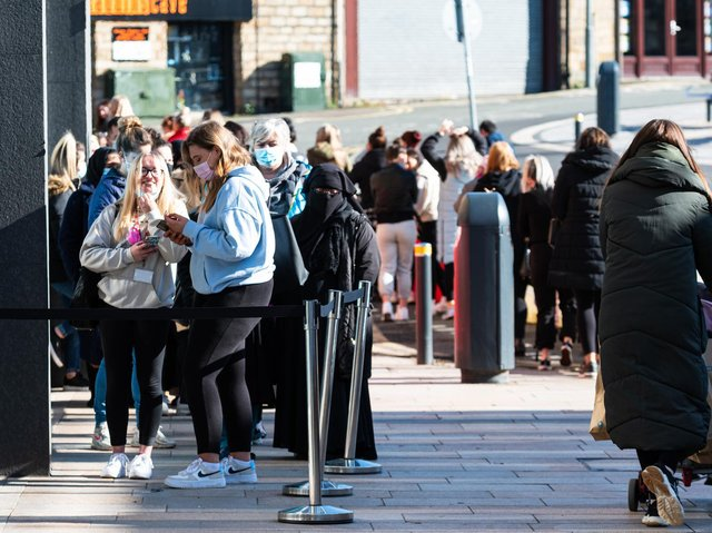 Shoppers queuing outside Primark in Burnley