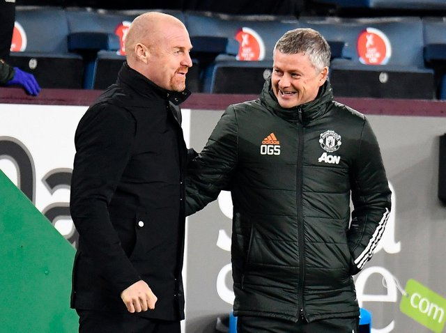 Burnley's English manager Sean Dyche (L) greets Manchester United's Norwegian manager Ole Gunnar Solskjaer during the English Premier League football match at Turf Moor in Burnley, north west England on January 12, 2021.