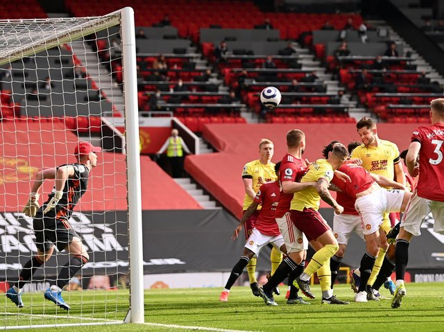 James Tarkowski of Burnley scores his team's first goal during the Premier League match between Manchester United and Burnley at Old Trafford on April 18, 2021 in Manchester, England.
