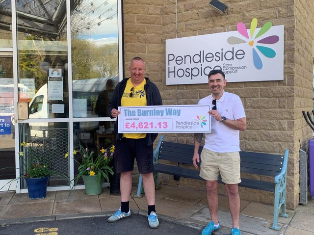 Daniel (left) and Kevin present a cheque to Pendleside Hospice for the cash they raised in honour of their grandma
