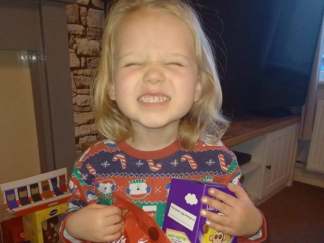 Three-year-old Emily delighted with her prize