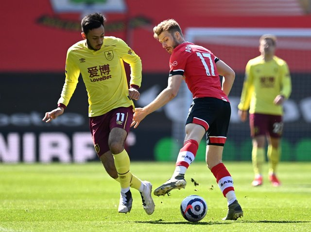 Dwight McNeil of Burnley battles for possession with Stuart Armstrong of Southampton during the Premier League match between Southampton and Burnley at St Mary's Stadium on April 04, 2021 in Southampton, England.